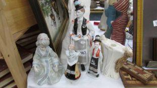 5 assorted ceramic figures.