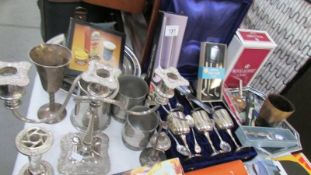 A mixed lot of silver plate including candelabra, goblets etc.