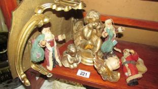 A gilded shelf bracket, 3 cherubs and 3 vintage Santa figures.