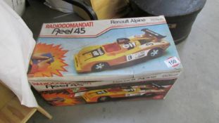 A boxed radio controlled Renault Alpine.