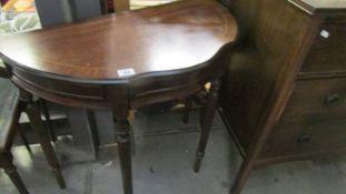An inlaid hall table.
