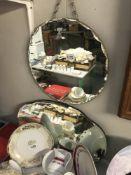 2 1930's bevel edge mirrors. Sizes 40.5cm diameter and 56cm x 33.