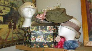 A quantity of vintage hats.