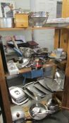 4 shelves of assorted kitchen ware including stainless steel.