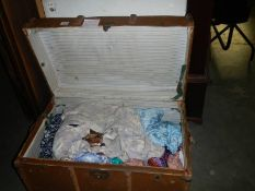 A travel trunk and textiles - retro dresses and fabrics.
