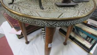 A brass topped table.