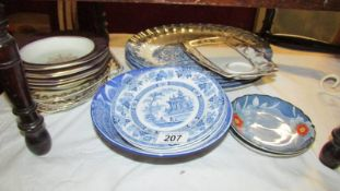 A mixed lot of plates and dishes.