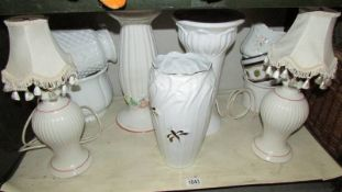 A mixed lot of vases, lamp bases etc.