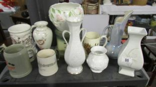 A mixed lot of vases, tankards etc.