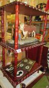 A mahogany 3 tier stand.