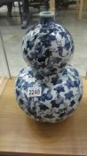A Chinese blue and white double gourd shaped vase.