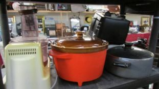 A slow cooker, food processor and other kitchen items.