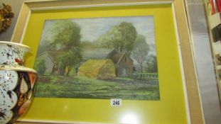 A framed and glazed watercolour farm scene.