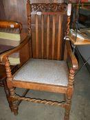 An Edwardian oak carver chair