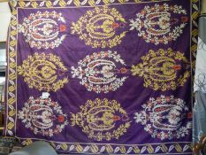 A large antique bed throw, some damage in places, (230 x 240 cm).