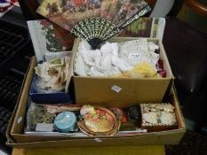 A box of haberdashery and miscellaneous items including cigarette silks, vintage buttons,