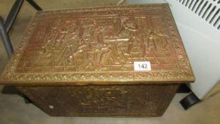 A brass log box.