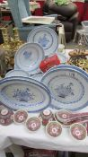 A quantity of Chinese plates and dishes.