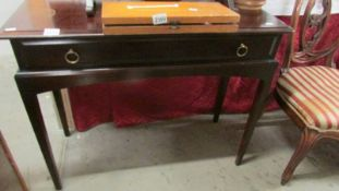 A mahogany single drawer side table.
