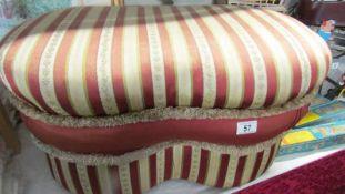 An upholstered stool.
