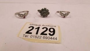 A silver marcasite ring and 2 other silver rings.