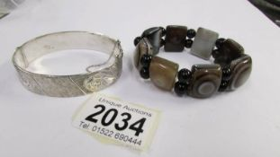 A banded agate stone set vintage bracelet together with a circa 1970's textured design silver