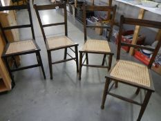 A set of 4 Edwardian chairs wirh reed seat panels