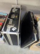 An aluminium edged case and a Crown brief case