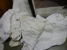 A quantity of old baby gowns, bonnets etc.