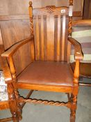 An Edwardian oak carver chair