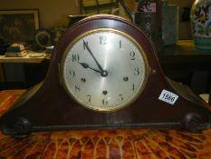 A Napoleon hat mantel clock.
