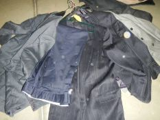 A quantity of men's suit jackets, 2 piece suits, various styles and sizes.
