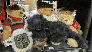 A shelf of soft toys with tags.