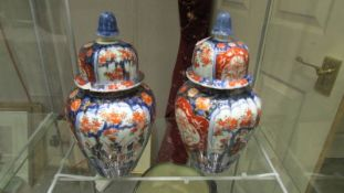 A pair of Chinese ginger jars, one a/f.
