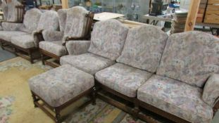 An Ercol five piece suite comprising 3 seat sofa, 2 seat sofa, 2 chairs and a stool.