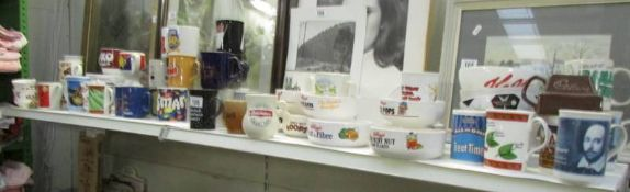 A large lot of advertising mugs and dishes.