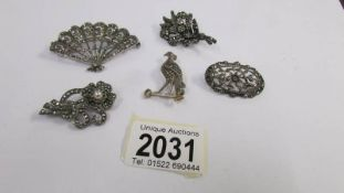 A collection of circa 1950's brooches in silver including an unusual fan brooch stamped NBs,
