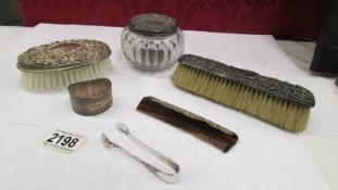 2 silver backed brushes, a silver mounted comb, a silver lidded powder bowl,