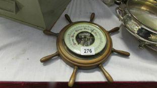 A ships wheel barometer.