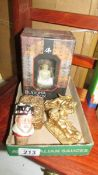 A pair of gilded cherub candle holders, a gilded cherub box etc.