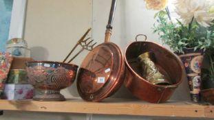 A copper warming pan, copper punch bowl, large copper pan, brass jug etc.