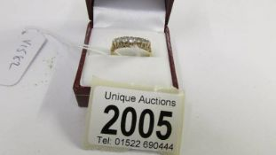 An 18ct 5 stone vintage yellow gold diamond ring, size N half.