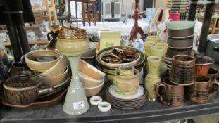 A shelf of assorted stoneware etc.