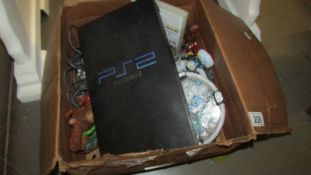 A box of miscellaneous including PS2.