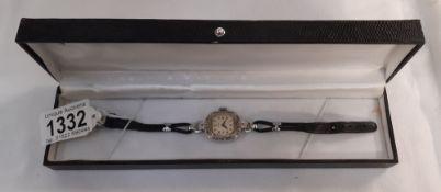 A ladies Timex wrist watch in box