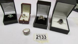 5 dress rings including one marked 9k and one silver.