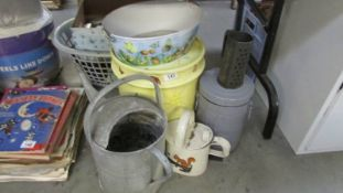 A quantity of watering cans, garden pots etc.