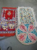 A prayer mat and 2 embroidered felt rugs