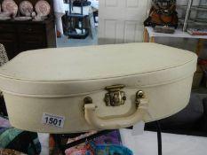 A small cream vintage vanity case