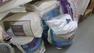 A quantity of new duvet's and pillows.